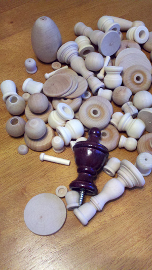 array of wooden finials and objects